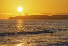 Catchin' a wave.... (Joe Hengel) Tags: ocean california ca sunset sea orange seascape beach water yellow clouds golden seaside surf waves glow outdoor surfer horizon shoreline surfing pacificocean socal shore surfers southerncalifornia orangecounty oc sanclemente danapoint seashore goldenhour goldenstate watchingthesunset