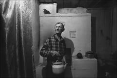 "The local shepherd Yurka known as ""Shut"" treats guests with tea (misha maslennikov) Tags: bw film nikon russia don f3 steep senshin maslennikov otherrussia"
