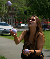 Juggling (swong95765) Tags: woman lady female concentration focus shades juggling juggler threeball