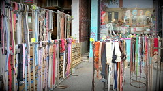 Shops displaying belts (Honey Agarwal) Tags: china street new people food toronto canada colour kitchen fruits vegetables mobile price shopping asian japanese graffiti downtown chinatown crossing dragon display market photos outdoor crowd chinese restaurants books east vietnam sidewalk electronics thai shops kensington language activity spadina dundas streetcar stores avenue neighbour decor signal seller neighbourhood shoppers stuffs dryfruits clicks prominent quiality orienntal