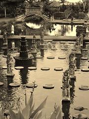 like a chess board (SM Tham) Tags: bridge trees people bali plants fountain monochrome gardens sepia reflections outdoors island asia statues walkways steppingstones paths ponds stonecarvings waterpalace waterfeatures karangasem tirtagangga amlapura gardenstosee