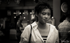 Moment of sadness (gunman47) Tags: street b people bw white black monochrome field sepia asian photography sadness 50mm mono eyes singapore asia thought sad faces bokeh f14 candid albert w expressions deep tourist east staff changer stop bubble shallow moment friday sg depth bugis decisive buying seah streetside