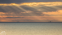 IMG_8969 (timothytripod) Tags: sun seascape beach water sunrise boat seaside ships explore rays shipping