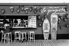 Barceloneta Beach (Sebastian Koenig) Tags: barcelona flowers blackandwhite bw white black beach bar canon perfect surf day chairs board sunny drinks barceloneta 70d