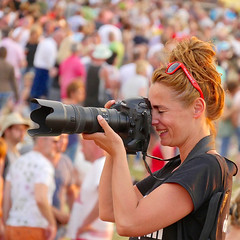 Festival photographer (andzwe) Tags: camera red woman netherlands smile sunglasses smiling festival female square big nikon photographer crowd large nederland size shooting rood bril roodharig crowded emmen telelens fotograaf redglasses redhaired vierkant fotografe retropop rtvdrenthe panasonicdmcgh4