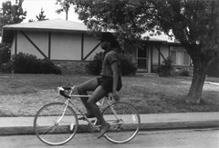 Random Fresno Scenes with John at the Wheel 3 (niiicedave) Tags: california hotguys oldpictures 1986 1980s nohands sanjoaquinvalley blackandwhitephoto bicyclerider tenspeedbicycle fresnocityincaliforniausa