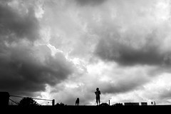 A man, his dog, his storm (EyeOfTheLika) Tags: street wallpaper sky people blackandwhite bw dog storm man black nature rain silhouette clouds outdoors grey crystal horizon perspective streetphotography palace lika distance epic 500px ifttt