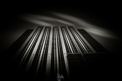 Reaching for the Sky #2 (Rohit KC Photography) Tags: sanfrancisco california ca city blackandwhite bw usa white black building up architecture clouds america skyscraper canon dark downtown day cityscape bright edited united states vignette lightroom canon24105mmf4l canon5dmarkii
