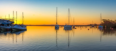 Sailing boats at dawn - pano (Anthony White) Tags: light christchurch contrast sunrise boats march mar still nopeople gb serene