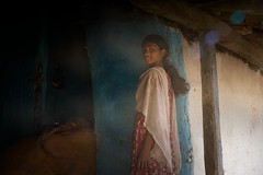 sunbeams (Handheld-Films) Tags: travel blue light portrait people india girl smile smiling eyes indian documentary shade portraiture flare sunbeams naturallighting rurallife madhyapradesh ruralindia indianvillages