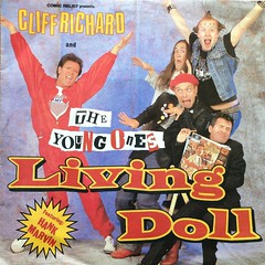 """Cliff Richard and The Young Ones - Living Doll, 7"""" / 45 rpm Vinyl Single Record. (firehouse.ie) Tags: prick mayall mike edmonson adrian ade rickmayal rik neil theyoungones record records recording vinyl album track tracks wax song tune rock music cliff richard the young ones living doll 7 45 rpm single 1986 wea comic relief"""