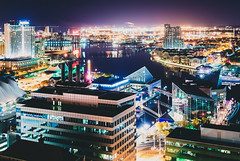 Tourism in Color (seikoesquepayne) Tags: city urban film night harbor haze nikon cityscape rooftops baltimore inner clear faux f18 v1 185mm