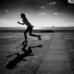 The Rollerskater (Simon Rutter Photography) Tags: sea blackandwhite speed mono movement action highcontrast promenade portsmouth seafront southsea rollerskater