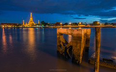Wat Arun (Kawinnings) Tags: city travel sunset holiday tower tourism water beautiful skyline architecture night river thailand religious temple dawn pier boat twilight ancient shrine asia cityscape place dusk bangkok background stupa traditional famous religion culture buddhism landmark east thai land attract spirituality southeast oriental chao wat vacations chaopraya attraction arun chedi phraya prang