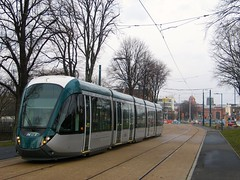Tram on Queen's Walk in the Meadows with the Railway Station in the background (ayeupmeduck) Tags: nottingham test net station walk meadows railway queens transit express trams the