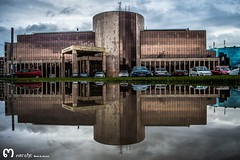 underneath the storm an umbrella saying... (ma_rohe) Tags: reflection arquitectura puddles reflejos reflects charcos