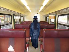 Niqab girl in train (Buses,Trains and Fetish) Tags: girl train coat hijab rail niqab burka chador