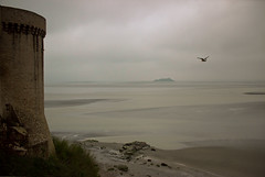 A Glimmer of Light (Missy Jussy) Tags: light sea sky mist france building bird tower water clouds canon landscape island coast rocks seagull atmosphere estuary monastery land normandy canon1855 lemontsaintmichel moodylandscape cannon600d
