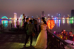 The Nam 021 (Cycle the Ghost Round) Tags: wedding sunset reflection love water night river evening engagement couple dusk marriage vietnam danang hanriver dragonbridge caurong