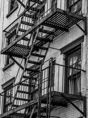 NY Tenement (Buzzin Hornets) Tags: nyc blackandwhite newyork metal rust fireescape tenement