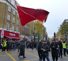 Waving Red Flag (Kombizz) Tags: uk people costa london justice massacre muslim islam faith religion battle tragedy shia muharram ashura hydepark karbala edgwareroad marblearch tyranny umayyad martyrdom caliph mourners flagholder yazid prophetmuhammad sufyan imamhussain ziaratashura ahlulbait ziyarat ziarat hazratabbas umayyads battleofkarbala ahlalbayt muslimummah kombizz 10thofmuharram sayyedalshohada shiitemuslims shimribnthiljawshan moonofthehashimites  imamzainulabedin muawiayh umaribnsad alialasghar saiydushshohada banuumayya yaabaabdillahalhussain imaamhussain ziyaratashura muharram1436 yaghamarbanihashem qamarebanihashim wavingredflag 1130042