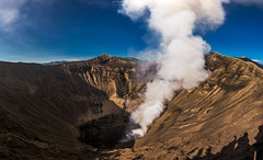 Crater of Bromo volcano, Java island, Indonesia (Mytruestory Photography) Tags: panorama nature vertical horizontal indonesia outdoors photography volcano java day nopeople geology rockformation volcaniccrater activevolcano mtbromo fumarole colorimage highangleview physicalgeography bromotenggersemerunationalpark mytruestory eastjavaprovince mytruestoryphotography rockobject