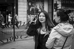 Getting The Point (Leanne Boulton) Tags: life street city uk light shadow portrait people urban blackandwhite bw woman white black detail texture girl monochrome face look female canon 50mm mono scotland living blackwhite eyes eyecontact pretty natural emotion humanity bokeh outdoor expression glasgow finger candid culture streetphotography streetlife scene depthoffield human shade 7d feeling gesture pointing society tone facial candidstreetphotography candideyecontact