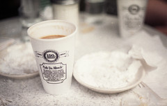 [cafe du monde] (world wide flan) Tags: new film field festival breakfast analog canon lens french table outside 50mm cafe orleans focus fuji ae1 bokeh jazz du sugar iso 400 quarter late nola shallow 18 fest monde depth nawlins powdered louisianna beniegt