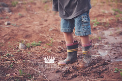 My boots got dirty (Adriana Varela Photography) Tags: boy childhood child mud boots dirty rainboots