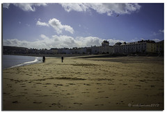 A WALK ON THE BEACH (vicki127.) Tags: sea people beach clouds sand footprints bluesky promenade hotels vicki llandudno northwales burrows digitalcameraclub flickraward ilovemypics canon650d ringexcellence lightroom4 vicki127 adobephotoshopcs6