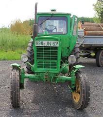 Old Russian tractor Belarus (:Linda:) Tags: tractor green germany log village thuringia belarus schwarzbach lumberpile greentractor eastgermanrelic