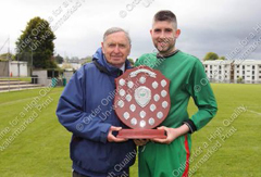 Bolton captain Kieran Rice with long serving Bolton official Dermot Walsh.