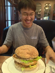 the biggest hamburger trey had ever seen. (brendan gibson) Tags: china boy man apple friend asia eating burger contest chinese inner mongolia hamburger prc challenge trey 4s iphone innermongolia hohhot appleiphone4s