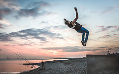 Airborne (Robbie Khan) Tags: sunset sea sky fish water 35mm canon seaside jump fisherman sigma solent 5d acrobat airborne neach