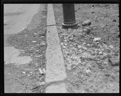 Glass in streets to cut auto tires (Boston Public Library) Tags: streets brokenglass worldwarii lesliejones