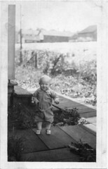 Happy baby on board walkway (Meyersdale Public Library) Tags: people babies 1910s infants 1900s porches photobox2 mccunealbum