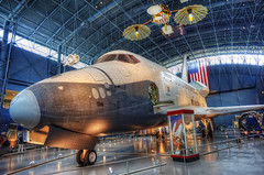 Red, White and Enterprise [Explored] (Dan Chui (on/off!)) Tags: city travel urban usa history museum architecture america buildings geotagged lights virginia washingtondc fly us nikon glow technology space aircraft aviation famous hangar flight tourists illuminated explore astronauts journey transportation planets 24mm enterprise universe discovery spaceshuttle metropolitan hdr futuristic nationalairandspacemuseum udvarhazy milkyway    spaceexploration spaceshuttleenterprise  d700