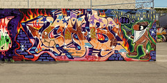 CAB (See El Photo) Tags: california ca street urban 15fav favorite usa streetart color colour art cali wall illustration canon outside outdoors eos rebel graffiti la losangeles wire parkinglot colorful gun colore mask bright grafiti vibrant character cab graf parking bricks mosh lot vivid rob urbanart size 09 thief otr barbedwire mirage fav graff bandit villain bandanna kts couleur razorwire crook volt robber grafite lod badguy faved 500d t1i cinderbricks