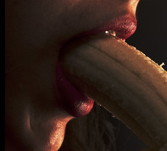 Food Porn #1 (JakeMaupinPhoto) Tags: red woman color girl yellow sex fruit photography jake eating banana lips bananas foodporn drugs redlipstick maupin nixion provocitive