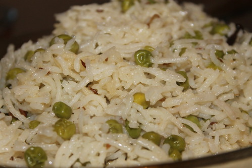 Pilau rice cooked with peas and served with desi kebabs (shami kabab)