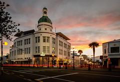My Kinda Town (ajecaldwell11) Tags: light sunset newzealand sky clouds dusk artdeco napier hawkesbay marineparade tgbuilding vision:sunset=0853 vision:outdoor=0903 vision:sky=0869 vision:clouds=0753