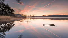 Reiteration (Dylan Nardini) Tags: morning blue trees winter red sky orange sun lake reflection water lines yellow clouds sunrise dawn golden scotland jet trails diamond shape 2015 lochard kinlochard cloudsstormssunsetssunrises