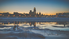 wintery omaha skyline (laughlinc) Tags: city cityscape downtown dusk firstnationalbanktower laughlinc lightroom lightroom5 longexposure matte missouririver nebraska nikon1755mm24 nikond80 omaha reflection river riversedgepark skyline snow sunset urban water winter woodmentower thechallengefactory nikon