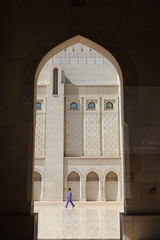 Arched (Elios.k) Tags: door camera travel november blue windows light shadow people man color colour reflection building travelling tourism motif vertical wall architecture canon walking outdoors photography one design sandstone gate asia arch walk indian muslim islam main religion arc middleeast belief style courtyard mosque inner arab porch frame overalls worker local marble arabian peninsula oman eastern muscat islamic grandmosque sahn sultanate sultanqaboos masqat bawshar 5dmkii