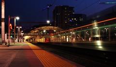 Union Station, Denver (Circled Thrice) Tags: city longexposure urban motion blur night train canon eos rebel colorado industrial cityscape denver trainstation co bluehour unionstation aline t3i rtd rapidtransit denverunionstation denveratnight