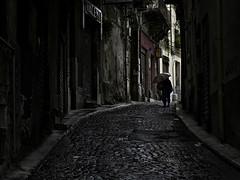 Walking in the rain (Ciro Rizzo) Tags: street photography urban fujifilm x20 architecture sicily city