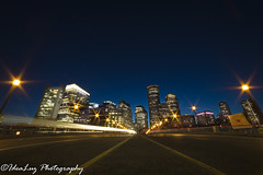 Hurry to Go (IdeaLuz Photography) Tags: road city bridge light cars boston 30 night buildings long exposure downtown cityscape nightscape skyscrapers shot nightshot outdoor district sony trails middle financial f28 seconds starburst 14mm a7ii rokinon