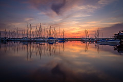 Silky reflections (daniel_moeller) Tags: longexposure sunset sky sun clouds germany landscape boats deutschland harbor europa europe sonnenuntergang harbour saxony beautifullight wolken boote leipzig sachsen hafen landschaft sonne ndfilter cospudenersee nd1000 lakecospuden sigma19mmf28dn sonyalpha6000 zbigkerhafen