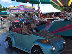"""Paul and Inde Ride the Cars at the Rose Festival • <a style=""""font-size:0.8em;"""" href=""""http://www.flickr.com/photos/109120354@N07/27243948544/"""" target=""""_blank"""">View on Flickr</a>"""