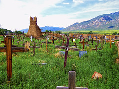 Taos Pueblo Cemetery (brucecarlson66) Tags: new travel sky mountain building tower tourism church monument cemetery grave graveyard grass garden landscape mexico living san cross bell native outdoor spirit indian headstone religion pueblo culture tourist clay adobe american mission quarter taos spiritual past attraction reservation indigenous primitive geronimo
